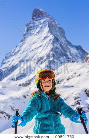 Skier girl with view of Matterhorn on a clear sunny day - Zermatt, Switzerland
