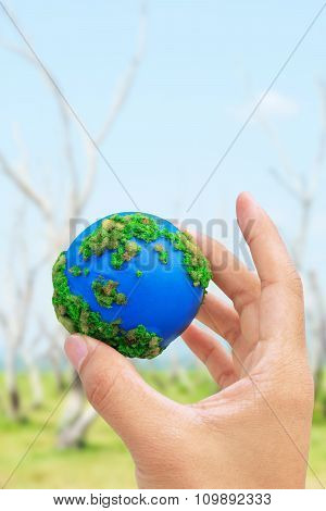Hands and Earth.