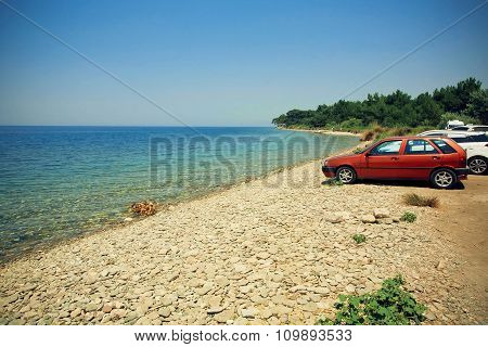 Sea View On Summer Travel Vacation To The Coast. Car Parking On A Beach.