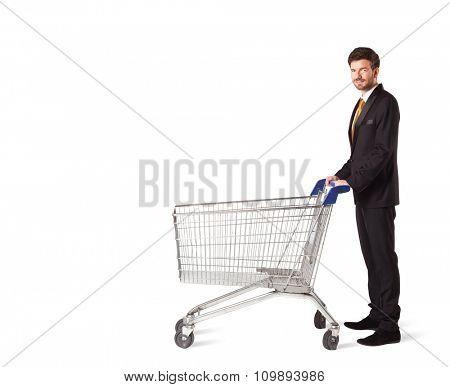 Businessman pushing a shopping cart on isolated background