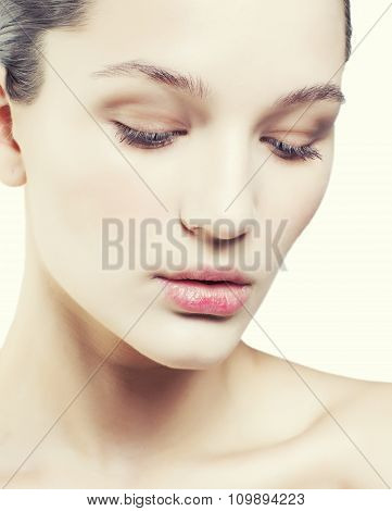 young sweet brunette woman close up isolated on white background, perfect pure innocense freshness