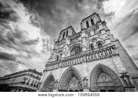 Notre Dame Cathedral in Paris, France in black white. Artistic grunge. Main facade view.