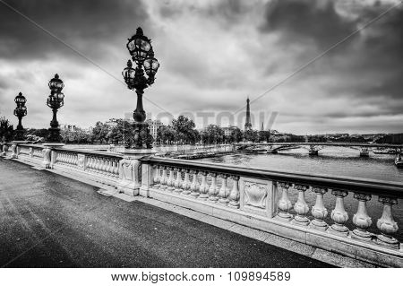 Pont Alexandre III bridge in Paris, France. Seine river and Eiffel Tower. Black and white