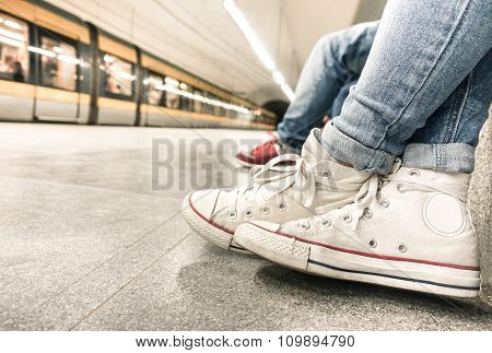 Young Girl Waiting For Train At Underground Station After Work - Urban And City Concept