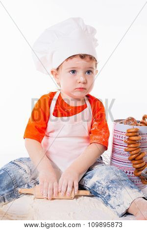 Baby Chef Sifting Flour Isolated On White Background