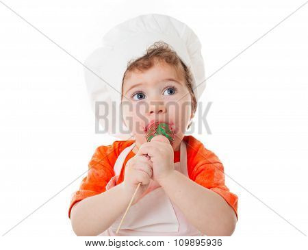 Baby Chef Eating Cake Pops Isolated On White Background