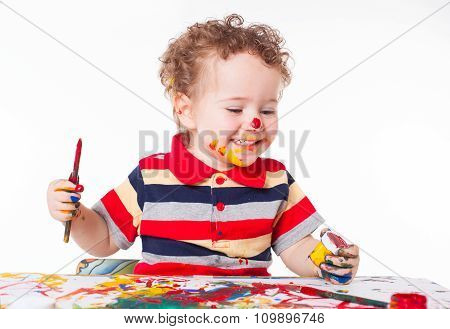 Cute Happy Baby Boy Playing With Paints