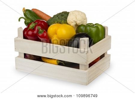 Fresh vegetables in the wooden box isolated on the white background.