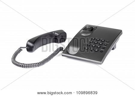 Desktop black phone with a handset on the table.