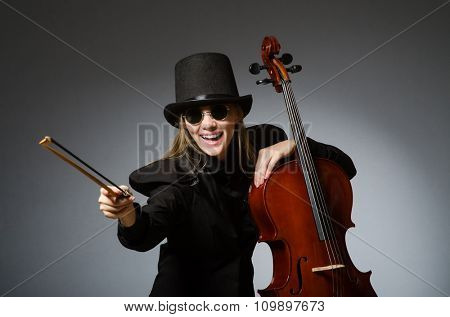Woman playing classical cello in music concept