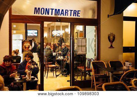 People Enjoying Cafe In Montmartre Cafe