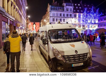 Police Car Patrol The Streets During Christmas Market