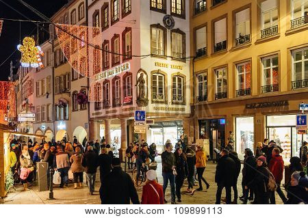 People Walking On The Main Street During Christmas Market