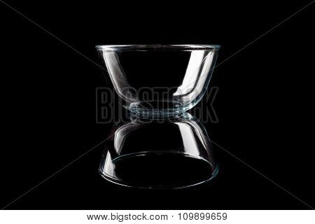 Glass bowl on black from side with reflection