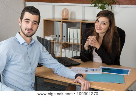 Two Happy Business People Meeting At Work