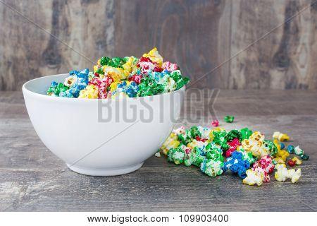 Sweet popcorn on wood