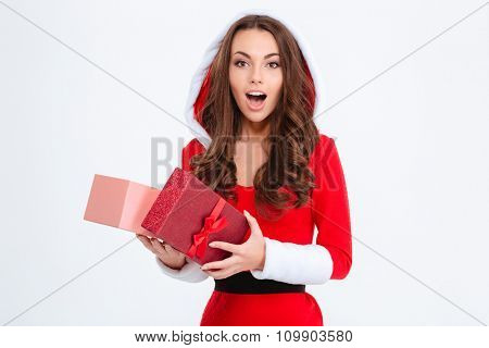Wondered pretty curly girl in red santa claus costume with hood opened her present isolated over white background