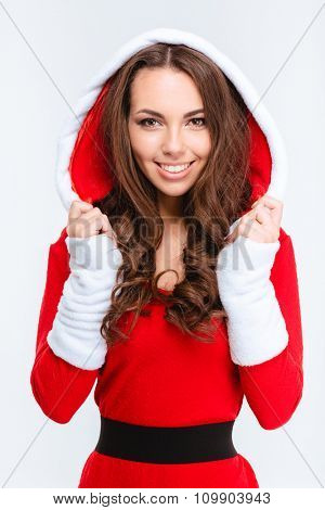 Attractive content curly girl in red santa claus costume with hood on white background