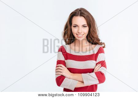 Portrait of a smiling woman with arms folded looking at camera isolated on a white background