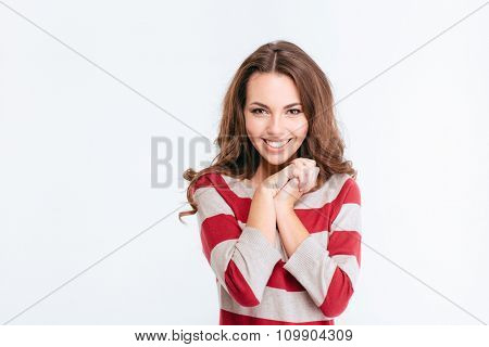 Portrait of a smiling pretty woman looking at camera isolated on a white background