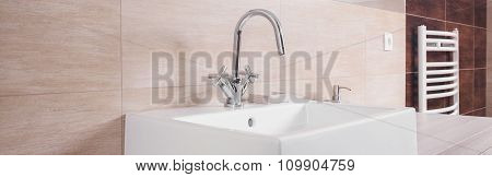 Porcelain Washbasin On Beige Background