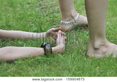 Close Up Of Yoga Pose In Grass