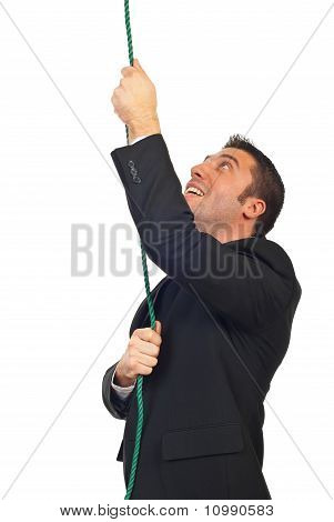 Successful Businessman Climbing Rope