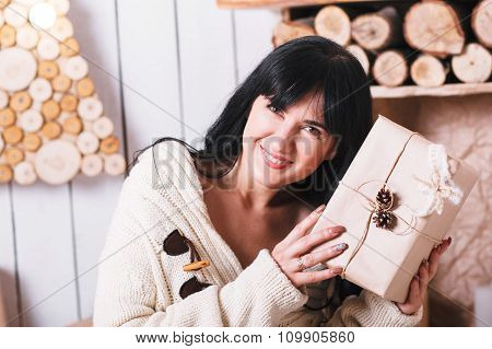 Happy Girl  Holding A Wrapped Christmas Gift