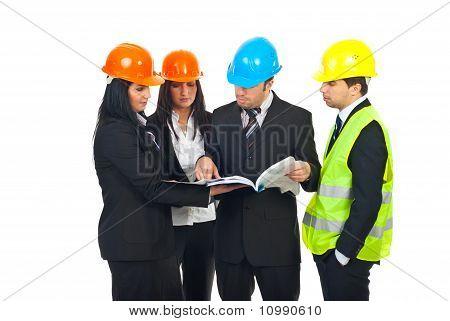 Engineers Team Examine Their Blueprints