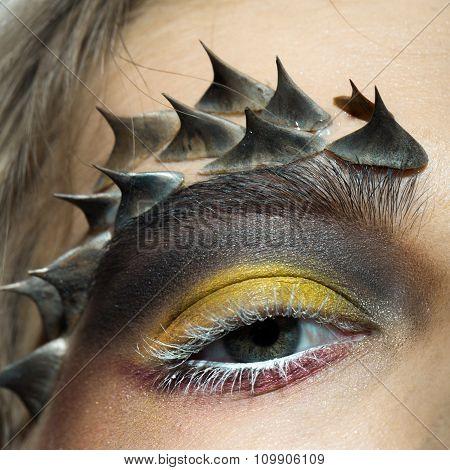 Female Eye With Thorns