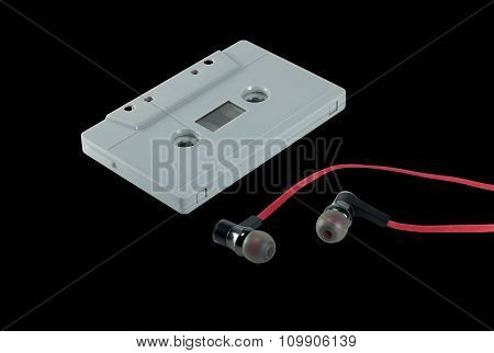 vintage cassette tape and red earphone