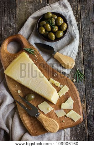 Parmesan Cheese On Woden Cutting Board