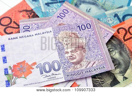 Photograph Of Australian Dollars And Malaysia's Ringgit Malaysia Currency.
