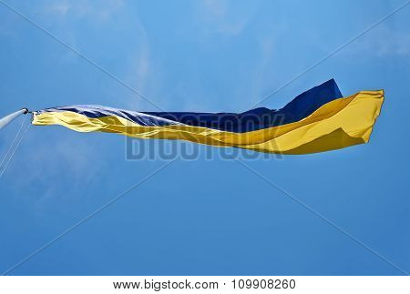 The national yellow and blue flag of Ukraine over the sky