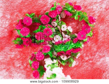 Artificial flowers as a heart.