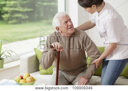 Man Leaning On Walking Stick