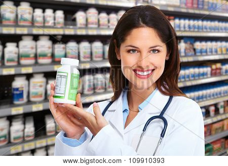 Medical doctor pharmacist woman over pharmacy background.
