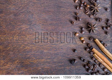 Coffee Beans, Cinnamon And Anise Stars On Dark Wooden Backround