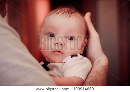 Baby On Father's Hand