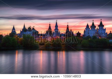 Izmailovo Kremlin Is Reflected In The Pond At Sunset, Moscow