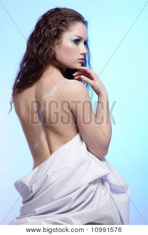 Beautiful Girl With Feather On Shoulder