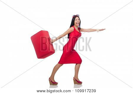 Woman in red dress with suitcase on white