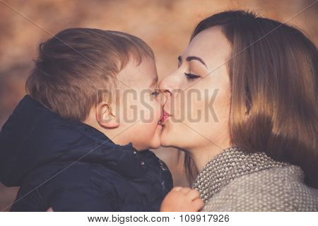 that is the sweet loving kiss, mom and sun kissing, beautiful autumn day, closeup, selective focus