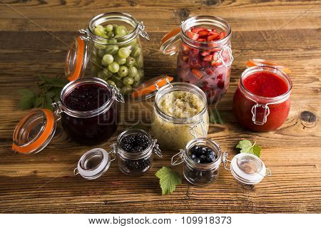 Jars of preserves, jams, fruit