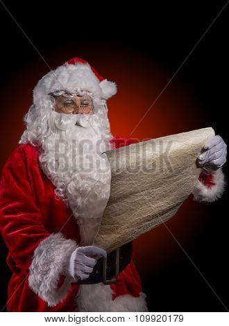 Santa Claus posing on dark red background.