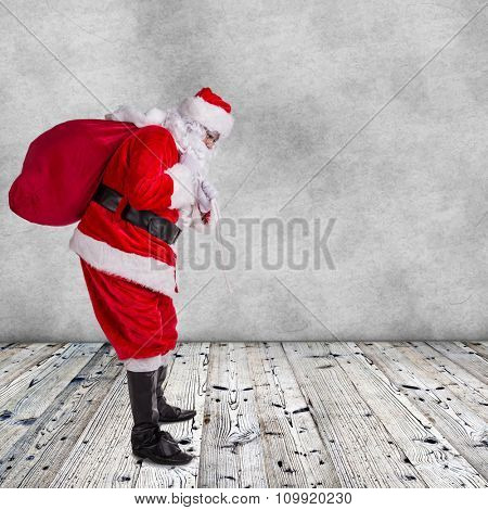 Santa Claus posing  on wooden background