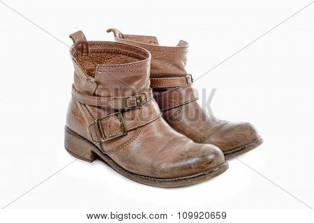 Pair Of Worn Boots Isolated On A White Background
