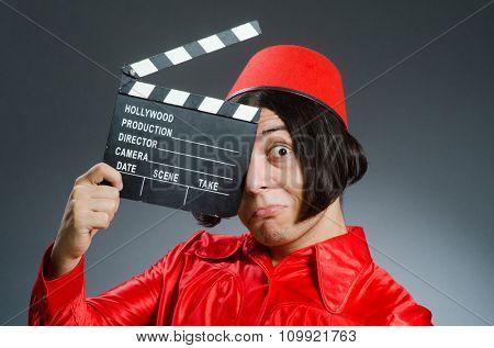 Man wearing red fez hat