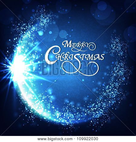Elegant sparkling greeting card design on blue background for Merry Christmas celebration.