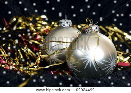 Two Silver Christmas Balls On Black Velvet